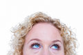Close up of pretty blonde woman looking up blond on white background Stock Image