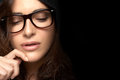 Close up pretty woman face with glasses cool trendy eyewear young looking down one hand on the gorgeous brunette fashion model Royalty Free Stock Photo