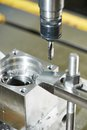 Close up process of metal threading machining tool thread former tap during cutting Stock Image