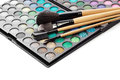 Close up professional multicolour eyeshadows palette make up brush makeup background Stock Photo