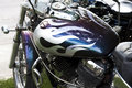 Close up of purple and silver custom motorcycle Royalty Free Stock Photo