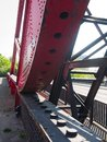 Close-up of the rack and pinion of an old rusty steel rolling lift bridge. Royalty Free Stock Photo