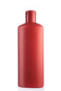Close up of a red bottle on white background Stock Photo