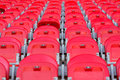Close up of red folded up seats in football stadium Royalty Free Stock Photo