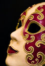 Close-up of red & gold carnival mask on black Royalty Free Stock Images