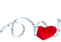 Close up red heart with measuring tape, isolated on white background Royalty Free Stock Photo