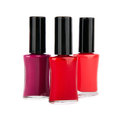 Close up of red nail polish flow isolated Stock Photos