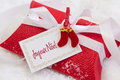 Close up of red present box with french text for christmas classic in and white Royalty Free Stock Photos