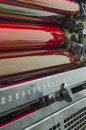 Close up of red rollers on print press machine offset printing industry Royalty Free Stock Photography