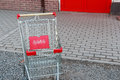 Close up of red shopping cart outside supermarket Royalty Free Stock Photo