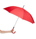 Close up of red umbrella in hand opened isolated on white Stock Photos