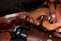 Close up of revolvers a two in holsters Royalty Free Stock Image