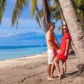 Close up romantic couple at tropical beach near palm tree in philippines this image has attached release Stock Image