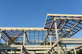 Close-up of roof construction home framing against blue sky Royalty Free Stock Photo