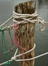 Close up of ropes on a weathered dock harbor in maine Stock Image