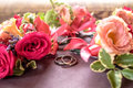 Close-up roses buttonhole and rings Royalty Free Stock Photo