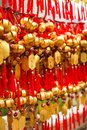 Close up rows Devotees hanging golden prayer bells for blessing at at Wong Tai Sin Temple, Hong Kong Royalty Free Stock Photo