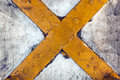 Close up of Rustic Yellow Metal Cross Royalty Free Stock Photo