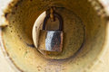 Close up of rusty lock on a yellow metal door Royalty Free Stock Image