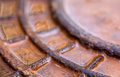 Close up of the rusty metal manhole cover with water Royalty Free Stock Photo