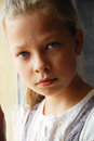 Close-up of sad pre-teen girl. Royalty Free Stock Photo