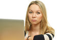 Close-up of a sad young woman in front of the laptop Stock Image