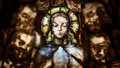 Close up of Saintly Figure in Stained Glass Royalty Free Stock Photo