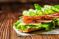 Close up of sandwich with ham, cheese, bacon, radish, lettuce, c Royalty Free Stock Photo