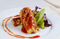 Close up saucy crispy chicken with sesame seeds delicious and vegetables on white plate Stock Image