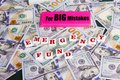 Emergency Fund:  Close up scattered US Dollars with message on pink eraser for really big mistake and emergency fund. Royalty Free Stock Photo