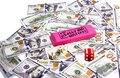 Close up scattered US Dollars with message on pink eraser for really big mistake and red dice with hearts Royalty Free Stock Photo