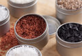 Close up of sea salts in tins Royalty Free Stock Image