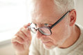 Close up of senior man in glasses looking Royalty Free Stock Photo