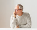 Close up of senior man in glasses thinking Royalty Free Stock Photo