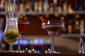Close up of several drinks colorful standing on bar Stock Photo