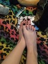 CLOSE UP - Sexy Female Pedicured Perfect Feet With Black Polish - Softest Feet You`ll Ever See