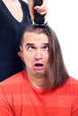 Close up of shocked long haired man being shaved Royalty Free Stock Photography