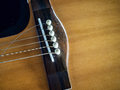 Close up shot of acoustic guitar with broken strings Royalty Free Stock Photo