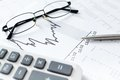 Close up shot of business documents and spectacles calculator pen diagrams Stock Photo