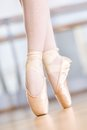 Close up shot of dancing legs of ballerina in pointes wearing white the hall Royalty Free Stock Photos
