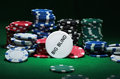 Close up shot of group poker chips on green table Royalty Free Stock Photo