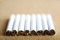 Close up shot of a line of cigarettes Royalty Free Stock Images