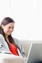 Close up shot of a smiling young woman using her laptop Royalty Free Stock Image