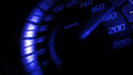 Close up shot of a speed meter in a car with blue light speed at 180 Km/H in concept racing car Royalty Free Stock Photo