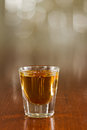 Close up of a shot of whiskey on a bar top Stock Photo