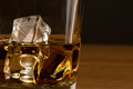 Close up shot of whiskey with ice cubes Royalty Free Stock Photos