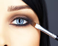 Close up shot of woman eye makeup face and brush applying mascara make on lashes Royalty Free Stock Image