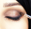 Close up shot of woman eye makeup face and brush applying mascara make on lashes Royalty Free Stock Photos