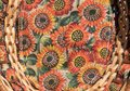 Horizontal close up of a sunflower cloth and wicker basket. Royalty Free Stock Photo
