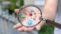 Close up on a sick man hand through magnifying glass transmittin Royalty Free Stock Photo